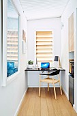 Narrow home office with table top and chair