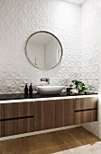 Bathroom with vanity units and white, three-dimensional wall tiles