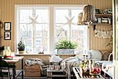 Paper stars in window in rustic living room