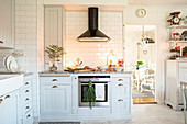 Festive decorations in white country-house kitchen
