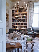 Illuminated bookcase in classic living room