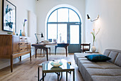 Arched window and Scandinavian designer furniture in living room