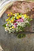 Bouquet of white cow parsley, red campion and yellow buttercups