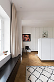 Storage space in white fitted cupboards and in central cabinets