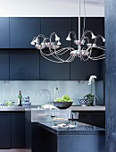 Modern chandelier in elegant kitchen