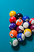 Racked pool balls on blue baize