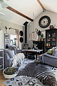 Grey sofa set and zebra-skin rug in living room