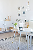 White furniture in Scandinavian-style living room
