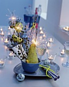 Table set with tealight holders and sparklers for New Year