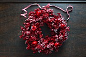 Christmas wreath of red berries and apples