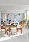 Columns and colourful eclectic furnishings