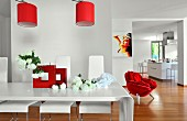 Red accents in white, modern loft apartment