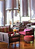 Dark furniture and low-hanging pendant lamps in hotel lounge