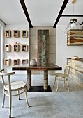 Industrial-style dining area with concrete floor and metal furniture