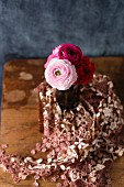 Bouquet of ranunculus on lace cloth