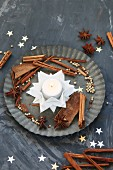 Folded white paper stars used as tealight holder