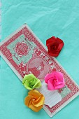 Paper roses on Oriental banknote