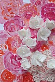 Paper roses on painted sea of flowers