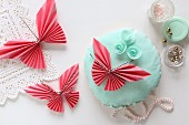 Folded paper butterflies and flowers