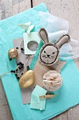 Easter mood board: fabric rabbit, gilt stone and paper