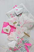 Translucent origami hearts with confetti on printed paper