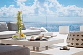 Luxurious terrace with view of sea through glass balustrade