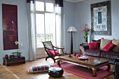 Oriental furniture in living room in shades of red
