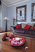 Flowers and teapot in living room in shades of red