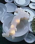Candle shaped like Italy on white plates