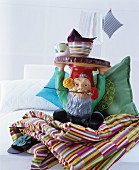 Garden-gnome side table and patterned home accessories