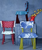 Chairs with hand-sewn covers made from various fabrics
