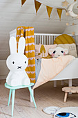 Rabbit lamp on stool in front of cot