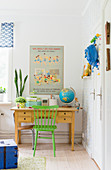 Green chair at desk in vintage-style child's bedroom