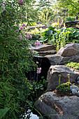 Water trickling over stone blocks in garden