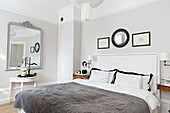 Two-tone walls in elegant, monochrome bedroom