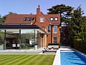 Brick house and extension with glass façades