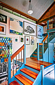 Art gallery in the stairwell with blue painted front