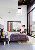 Bedroom with modern ethnic flair in the architect's house
