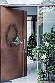 Minimalist Christmas wreath of a modern metal door