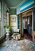 Animal fur and amphora chair with houseplant in vintage ambience with ornamental tiles