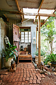 Lion sculptures and planted troughs on vintage porch with tile slabs