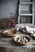 Qualis eggs on a country kitchen table