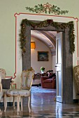 Festively decorated door frame in parlour of historical country-house villa