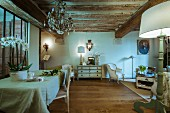 Rustic wood-beamed ceiling and antique furniture in renovated period building with historical ambiance