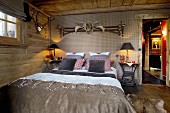 Hunting trophies in rustic, country-house-style bedroom