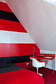 Red, white and black stripes on wall in attic bedroom