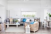 Lounge with gray sofa, coffee table and seagrass armchair