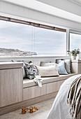 Bespoke bench with cushions under panoramic window