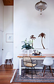 Table and two chairs on white wall