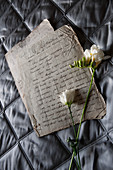 Freesia and Eustoma on old handwritten letter